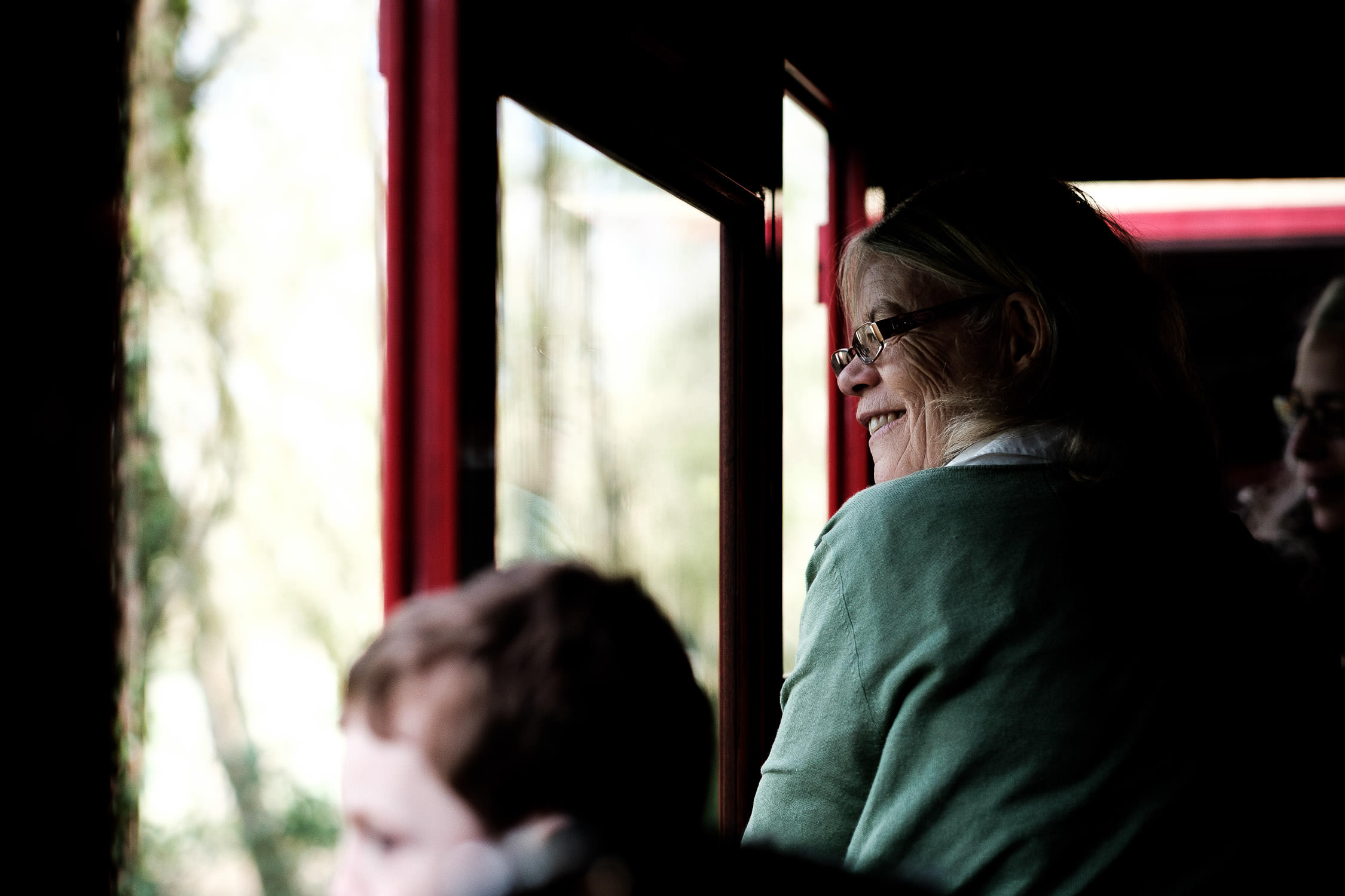 grandmother smiling on train