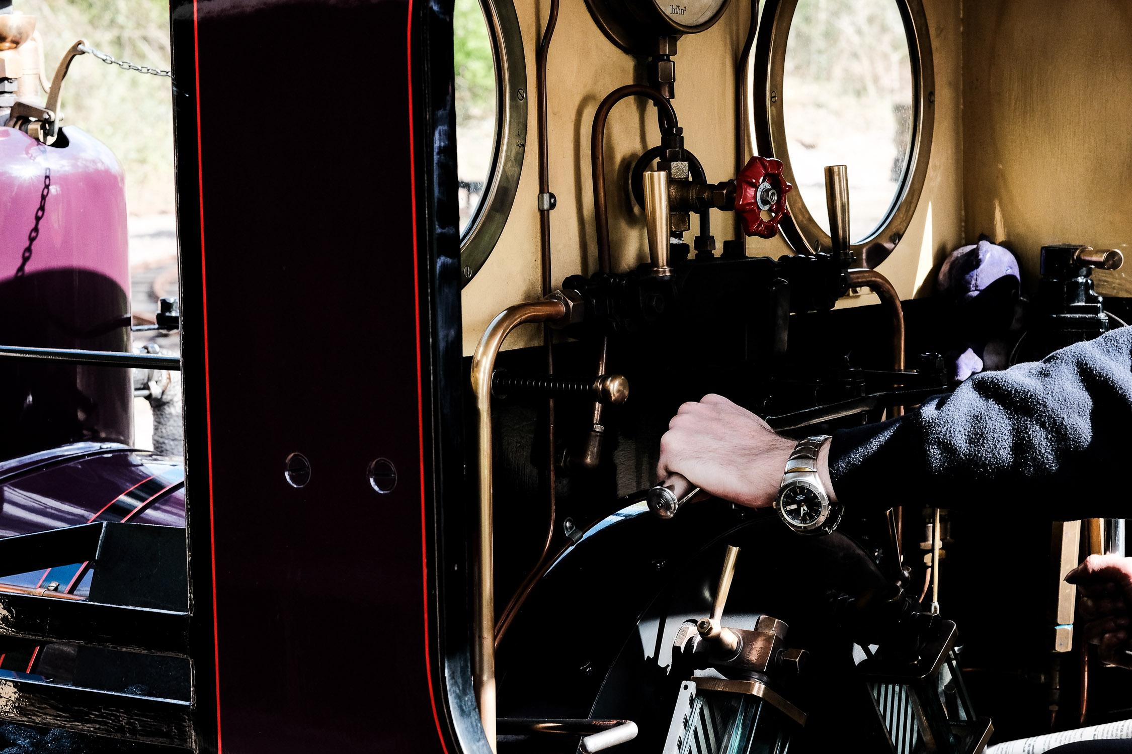 levers inside steam train cabin