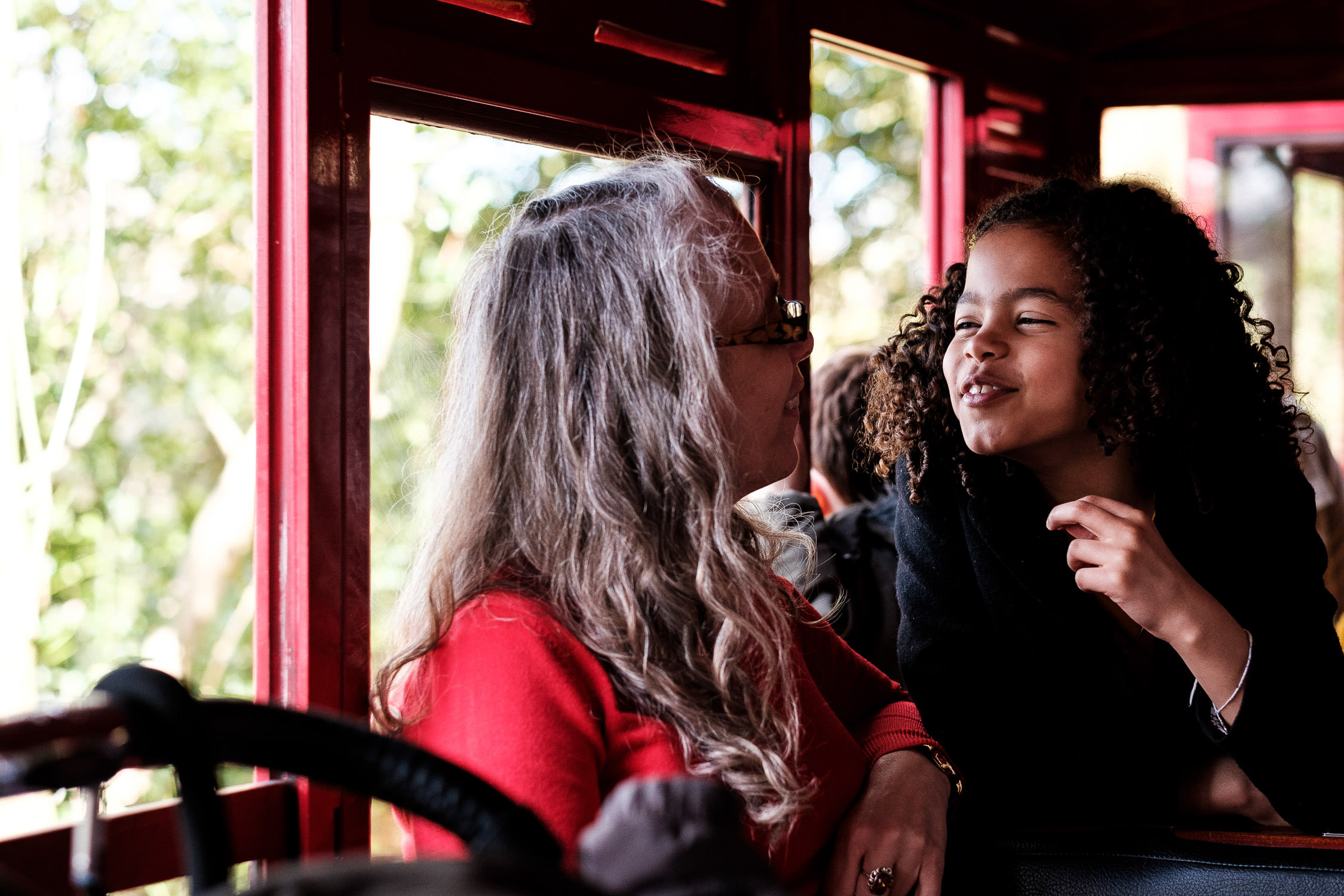 girl smiling on train