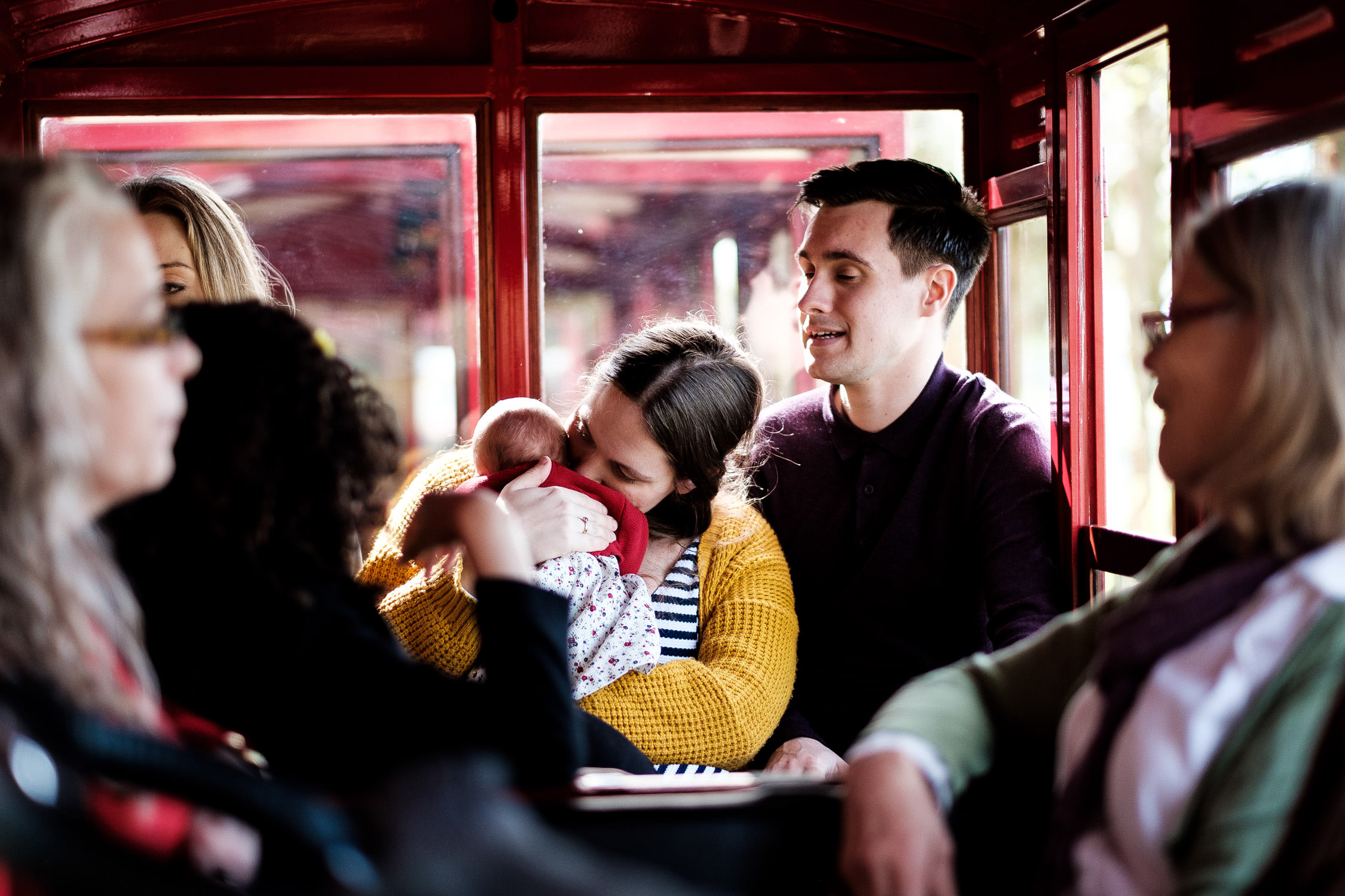 mother kissing baby on train