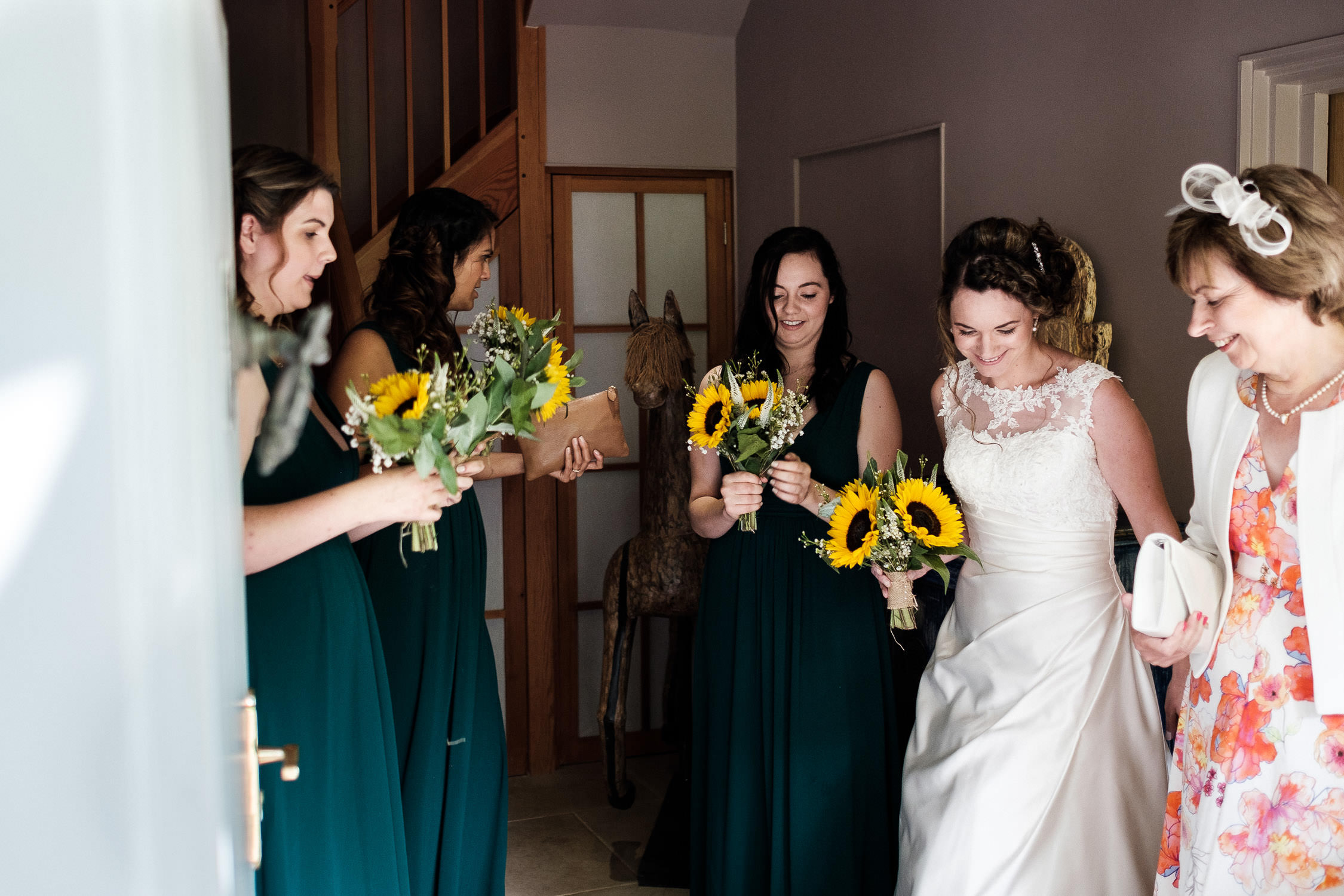 bride with bridesmaids waiting for ceremony