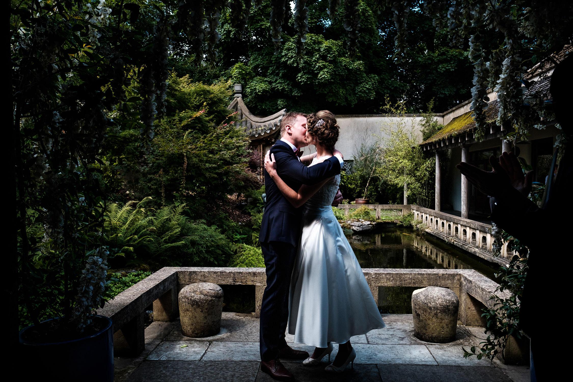 bride and groom kissing at matara centre