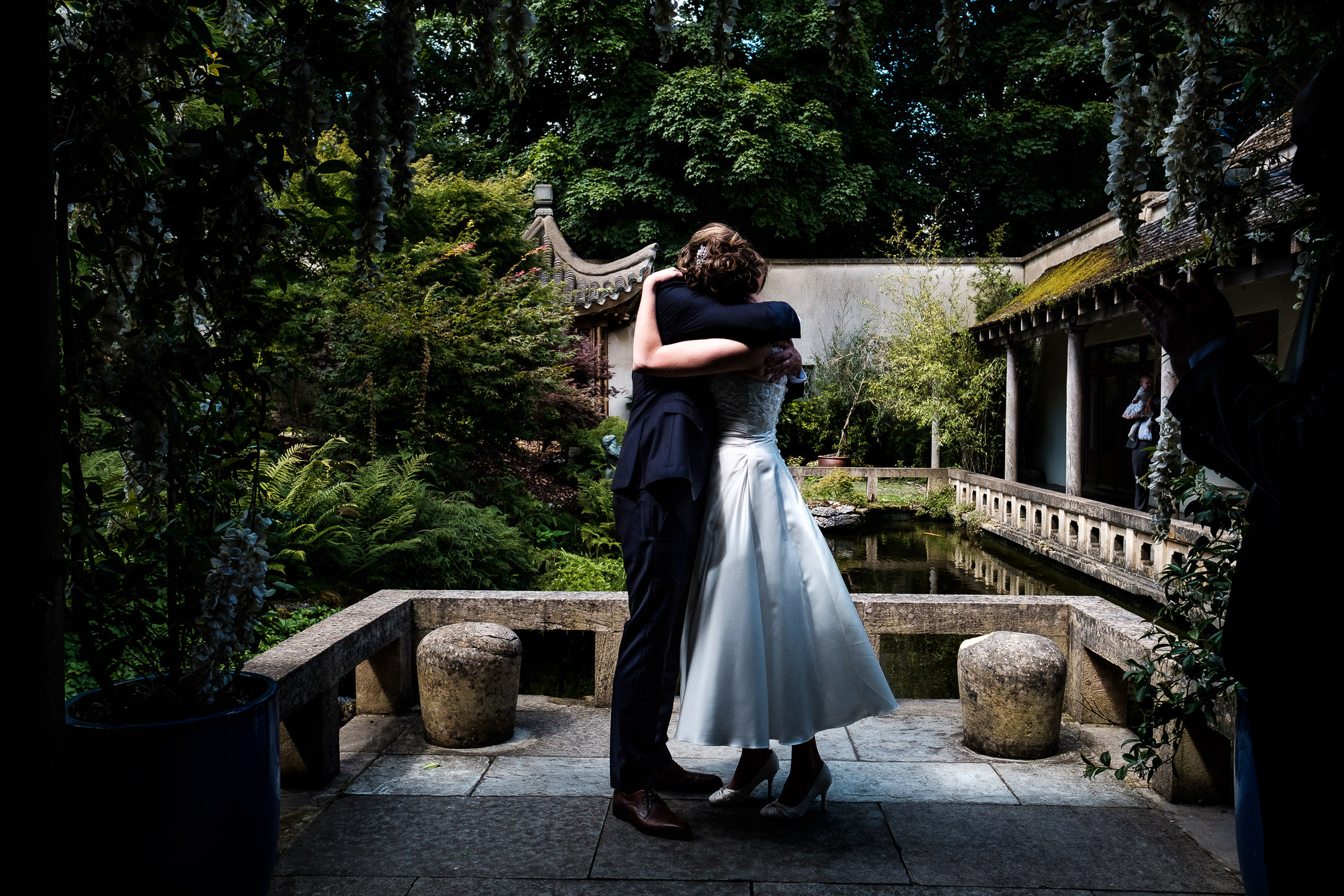 bride and groom hugging at matara centre