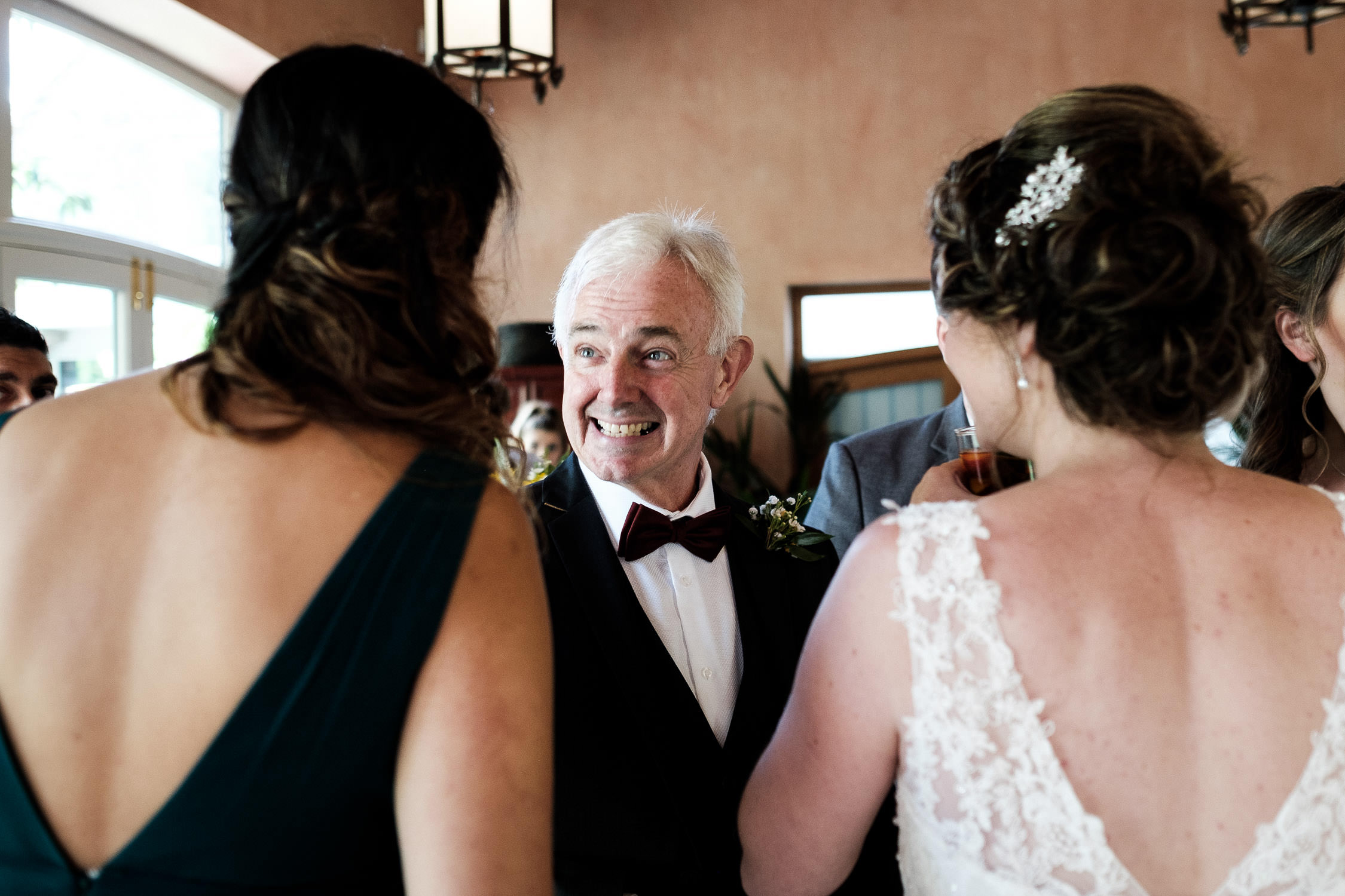 father of the bride smiling at wedding