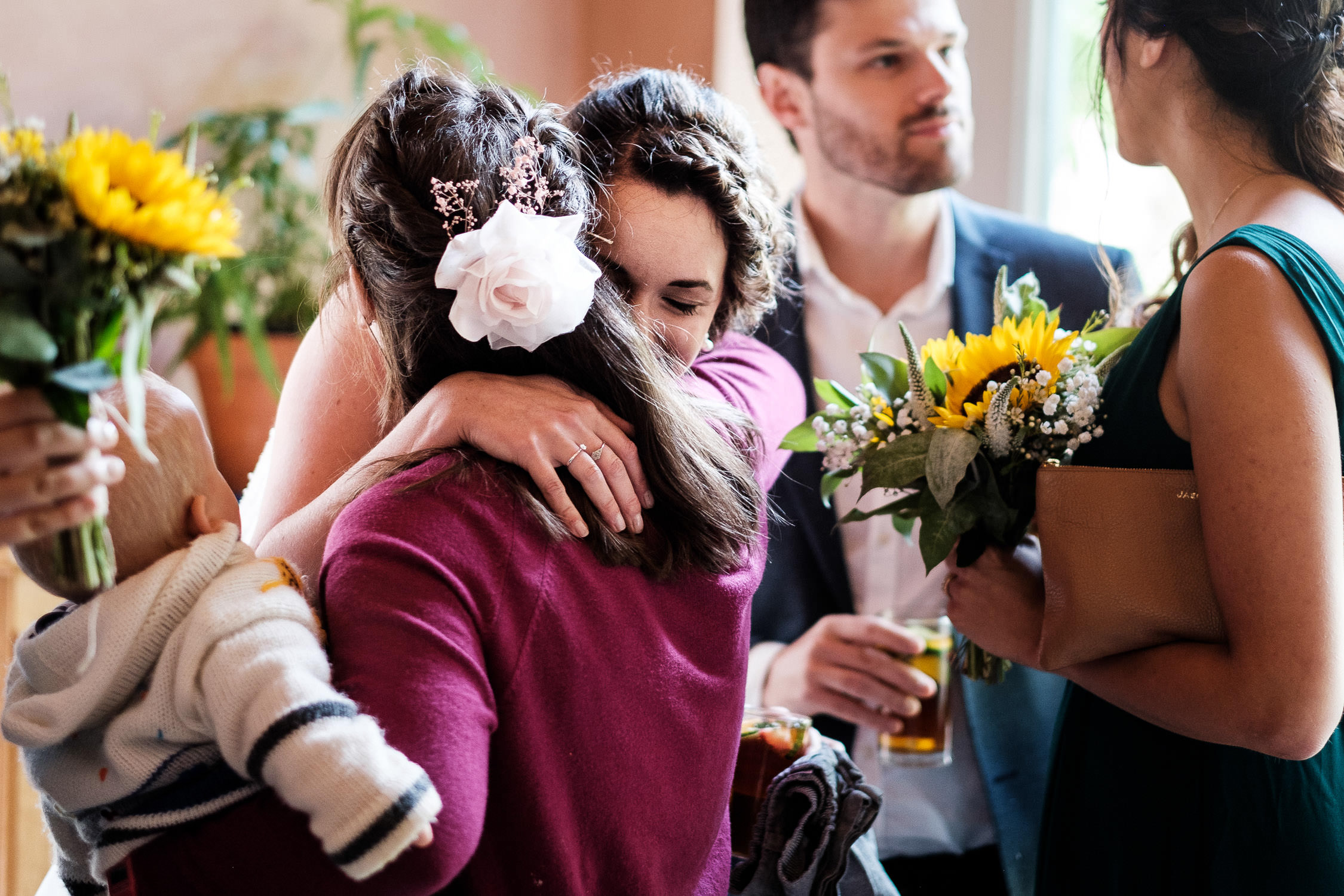 bride hugs a guest at matara