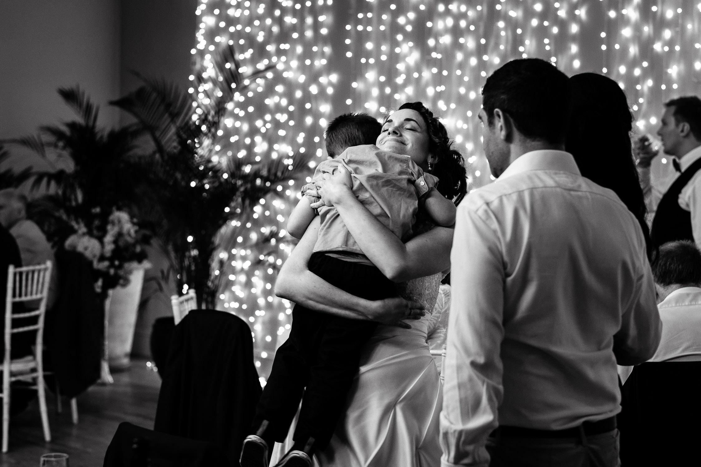bride hugging boy