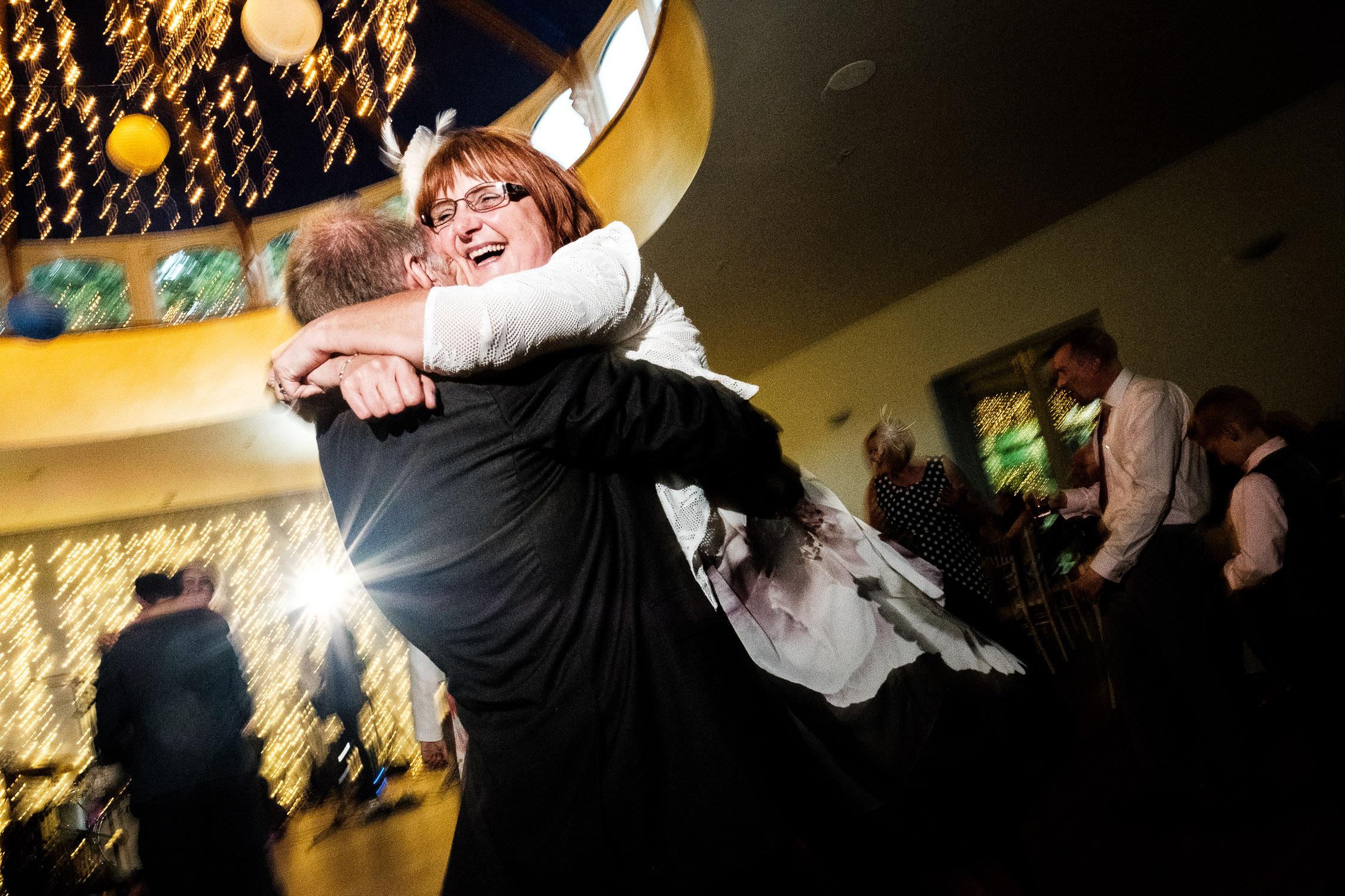 man picks up woman on dance floor