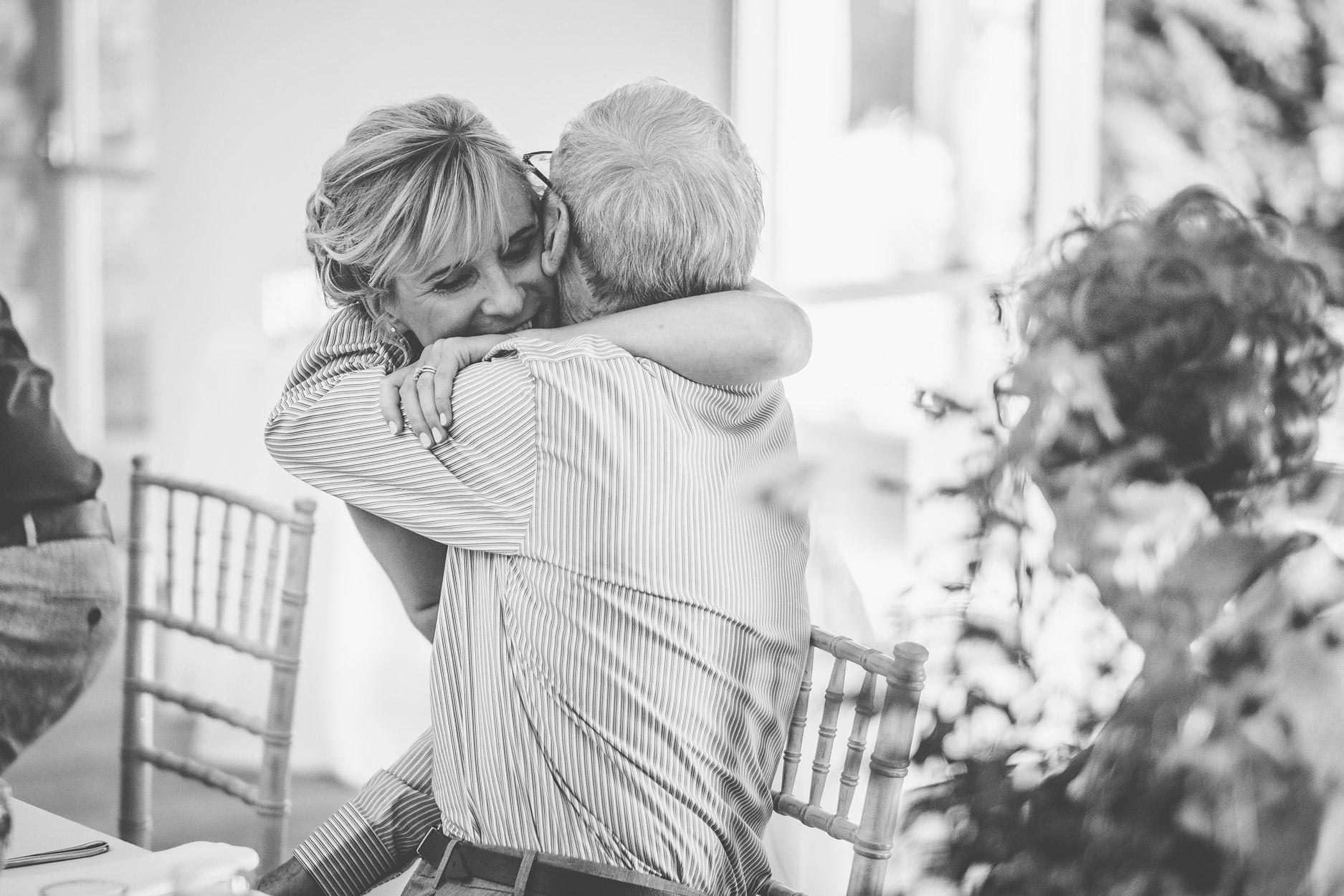 bride hugging father after wedding speech