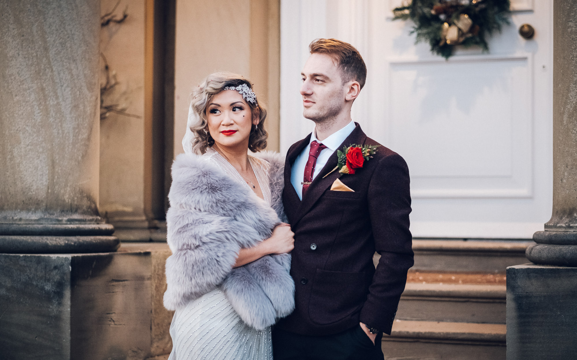 bride and groom standing together wedding photography